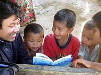 Kit, a first year student in Laos, reading aloud Big_Brother_Mouse