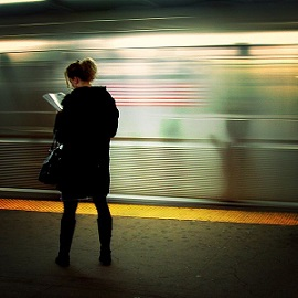 Woman reading at the station